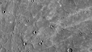 Fig. 2. Extensive flows cover many craters at north pole of Mercury