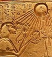 Akhenaten as Sphinx worshiping Aten