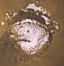 Fig. 2 Evidence of the whirlpool flow into the north pole vent (marked) on Mars.