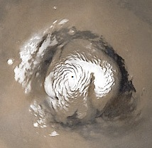 Figure 1. Water ice whirlpool on 3 km high island at Mars north pole.