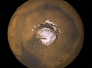 Fig 3 NASA mosaic of Mars northern hemisphere with mountain arc at lower right.