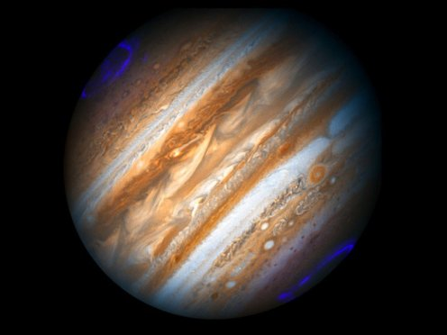 Fig. 1 Bright patches glow in Jupiter's ultraviolet aurora observed by the Hubble Space Telescope. Credit: Sarah Badman (Lancaster University), NASA, ESA